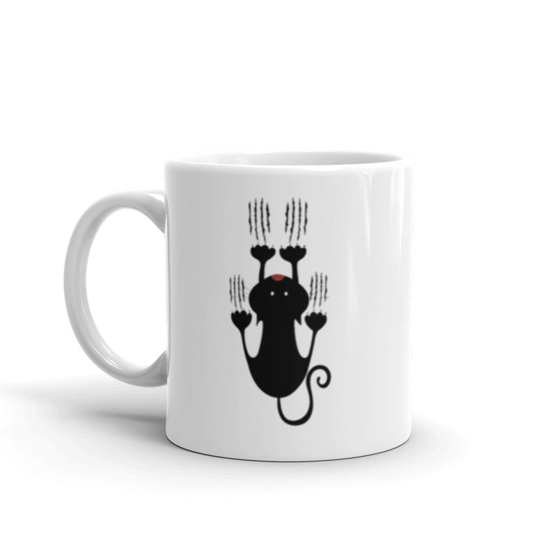 white mug with black cat and scratches design