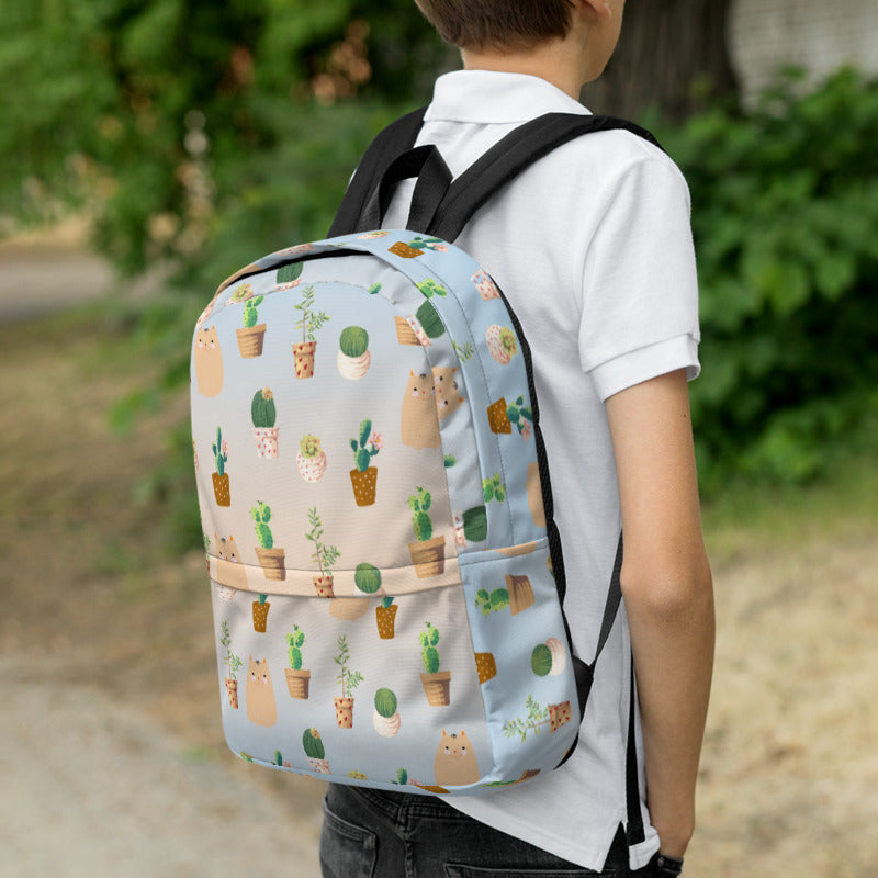 Boy wearing cactus and cat pattern backpack for back to school