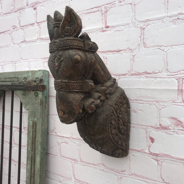 Carved horse head wall statue
