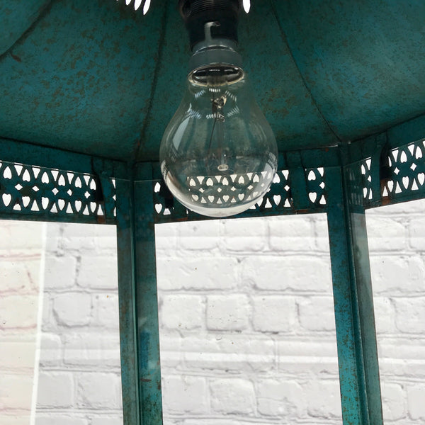 Rustic hanging hurricane lantern wired to plug into UK power outlet