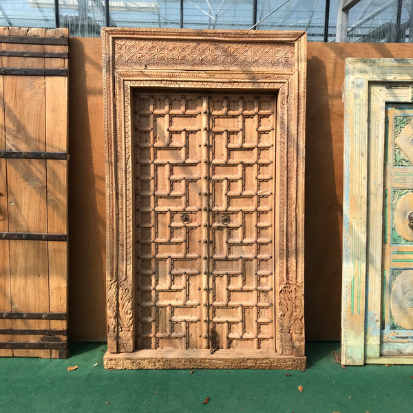 Antique carved teak Indian door with studs (H212cm | W129cm)