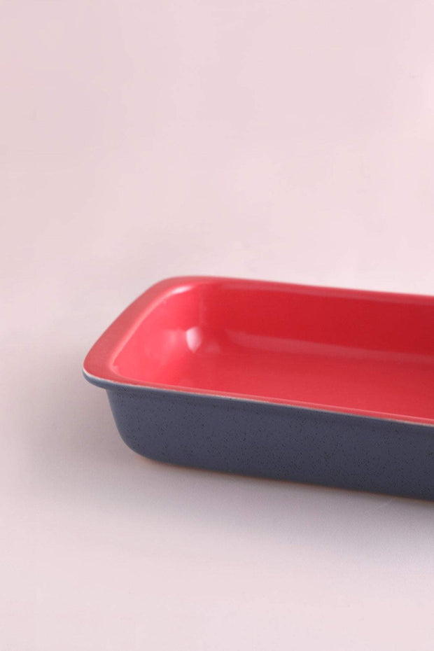 A Small Ceramic Baking Dish In Grey/Coral Color And Handcrafted Style