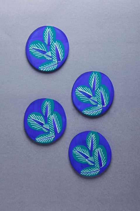A Set Of 4 Wood Coasters In Blue Color And Handcrafted Style
