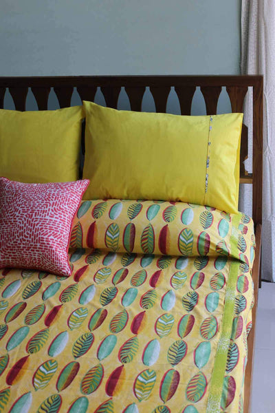 A Double Cotton Sheeting Bedcover In Yellow Color And Screen Printed Abstract Botanical Design