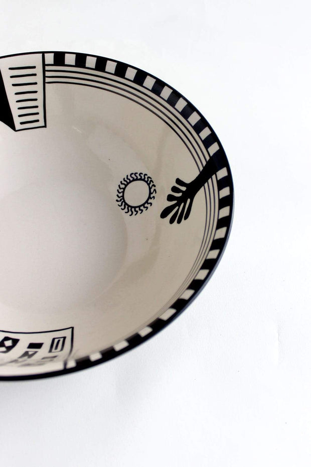 A Large Ceramic Round Bowl In Black Shade And Handpainted Design