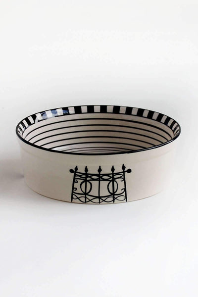 A Large Ceramic Straight Server In Black Color And Handpainted Style