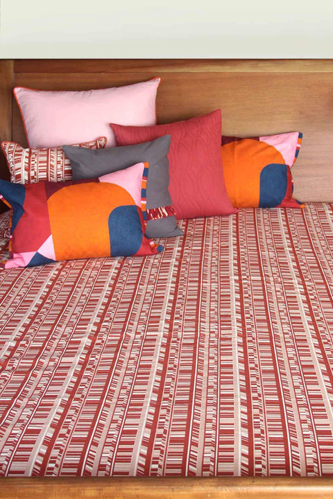 A Single Cotton Sheeting Bedcover In Dusty Pink/Rust Shade And Screen Printed Geometric Style