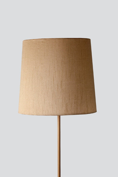 A Medium Cotton Sheeting Taper Lampshade In Gold Color And Handcrafted Style