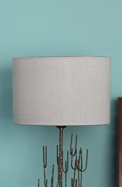 A Medium Cotton Sheeting Drum Lampshade In Grey Color And Handcrafted Design