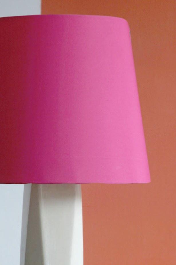A Small Cotton Sheeting Taper Lampshade In Pink Color And Handcrafted Design