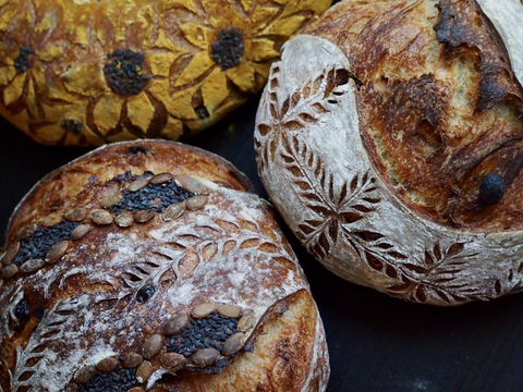 Picture of scoring on sourdough country loaves