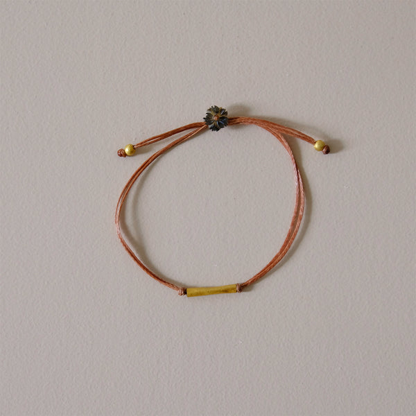 Gold Bar on Taupe Nylon Bracelet