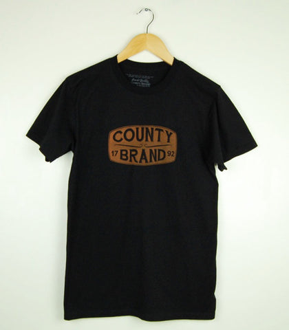 Men's Modern Crew T-Shirt • County Brand 1792 • Texas Orange Ink on Black