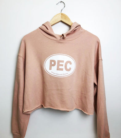 peach colour crop women's sweatshirt with PEC oval screen printed design from prince edward county