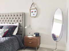 Free Standing Swivel Mirror and quilted bedspread