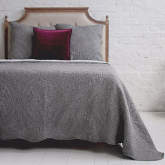Grey quilted bedspread