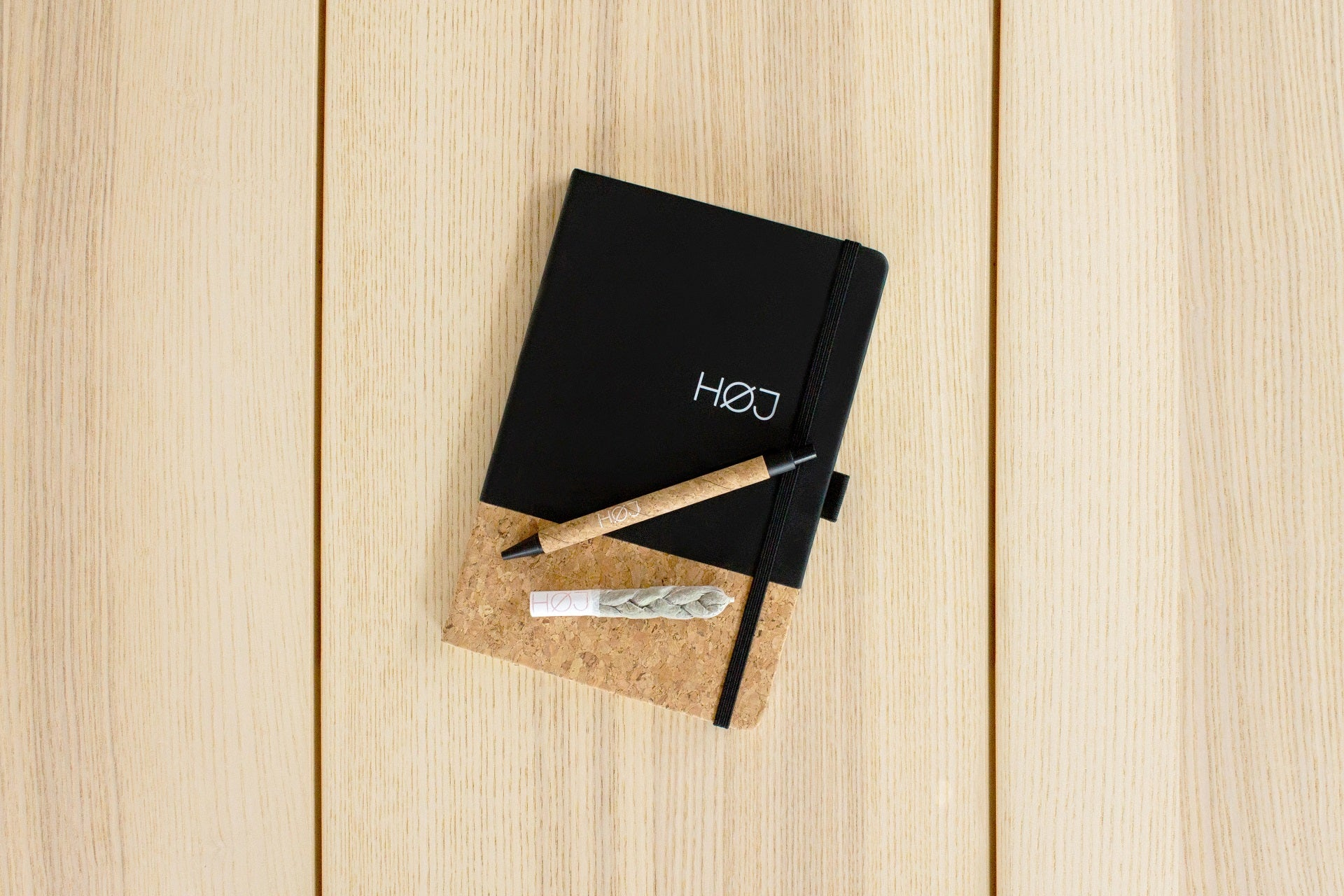 A fancy braided joint on a notebook with a pen