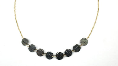 Perforated pearl necklace