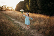 Load image into Gallery viewer, little girl dancing and skipping through meadow with sunset in the background wearing a flower crown wearing her glitter sparkle handmade jersey dress party disco occasion dress inspired frozen elsa sustainable
