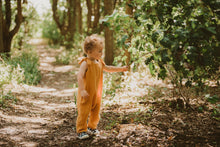 Load image into Gallery viewer, toddler boy stands in forest in orange bohemian romper adjustable straps unisex hippy clothing baby girl curly hair sustainable handmade