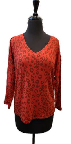 Nally & Millie Animal Print V Neck Top