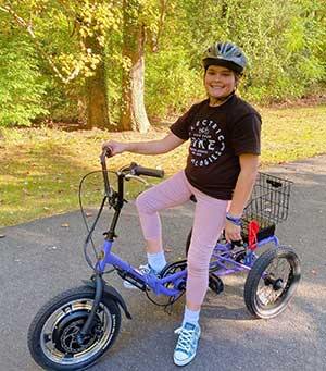 For Allison Heinrich, an 11-year-old with spinal muscular atrophy, having an electric bike allows her to feel like a normal kid again.