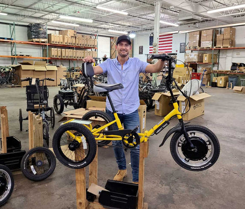 Jason Kraft, CEO of Electric Bike Technologies, stands with a Liberty Trike. Since January, Kraft has gifted 10 electric tricycles to kids with spinal muscular atrophy.