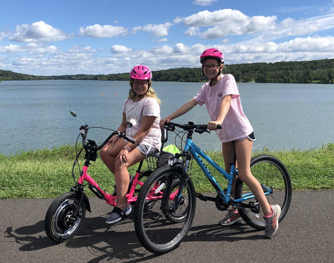 Doylestown's Mckenna Ellixson, left, and her sister Meghan, right, head out for a bike ride at Buck County's Peace Valley Park.