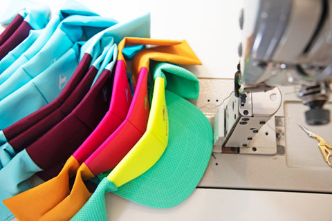 colorful kea peak visors in progress at sewing machine