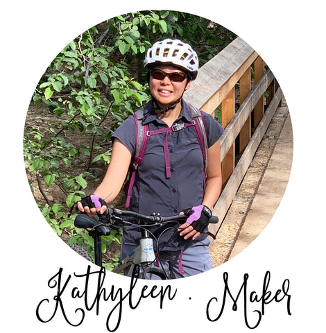 hat maker kathleen on mountain bike