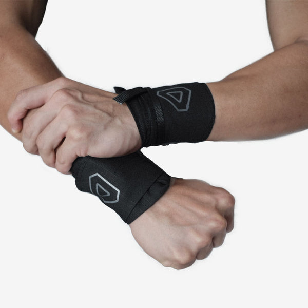 Arms with grav wrist wraps holding together