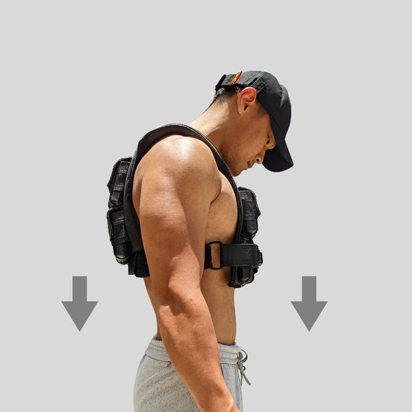 Male wearing grav weight vest from GRAVGEAR with upright form