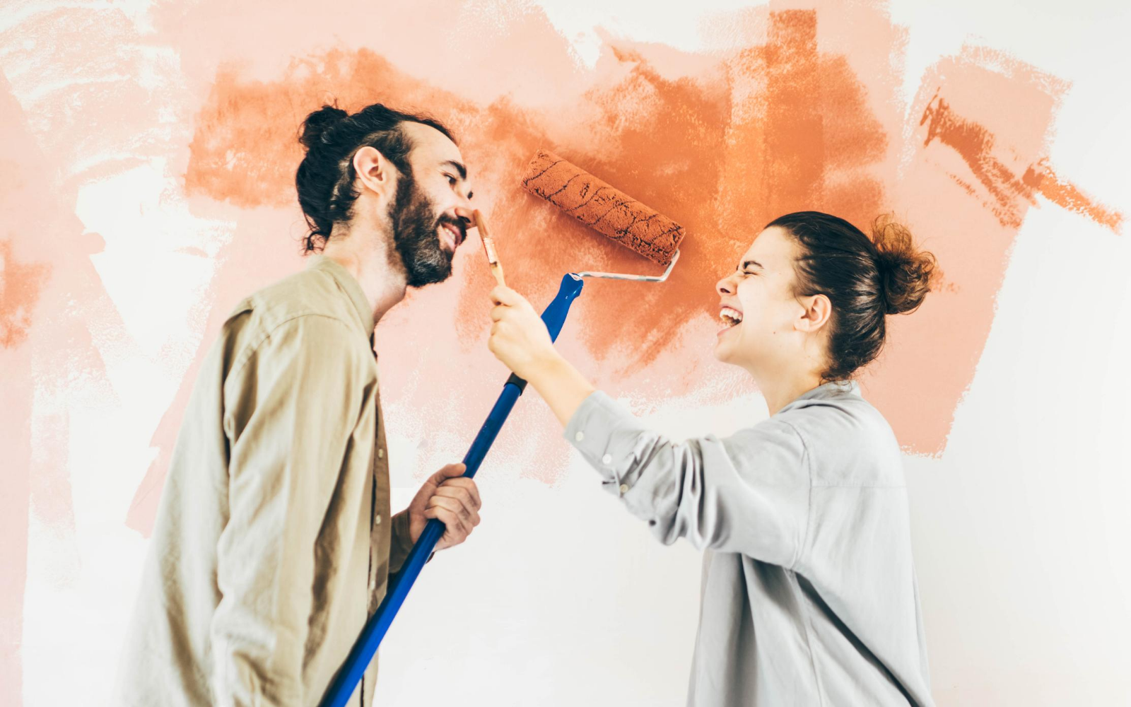 Couple Painting Orange Wall