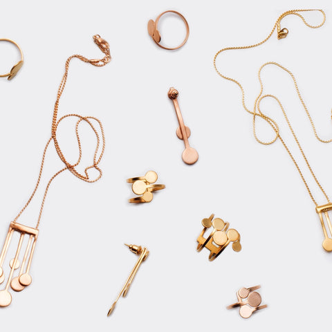Modern minimalistic jewelry collection by Pargo Jewelry. Made in gold plated copper and brass.