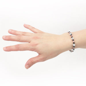 Pink, Black and White Mini Dice Bracelet on wrist