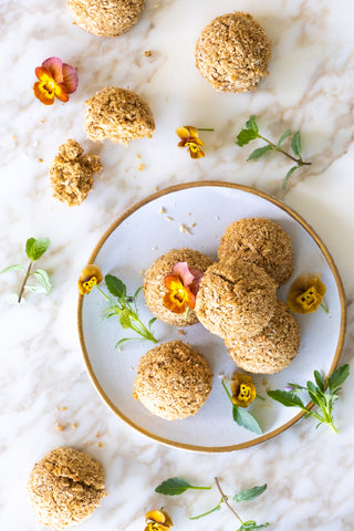 coconut macaroons on white plate with flowers