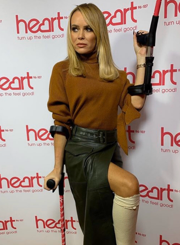 Amanda Holden Poses with Heart FM Branded Cool Crutches