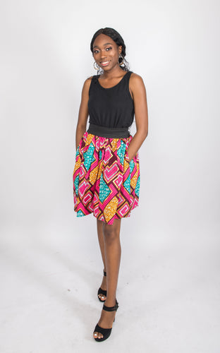 NIO STYLES │ Pink print maxi skirt with side pockets. Elasticated waistband and short length. This a classy office wear and can also be worn to a party. Gracefully styled.