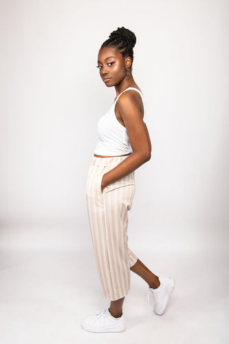 NIO STYLES │ Cropped length striped beige culottes... pair this contemporary high rise pant with a white tank top and a pair sneakers to achieve a cool summer look.. Shop now
