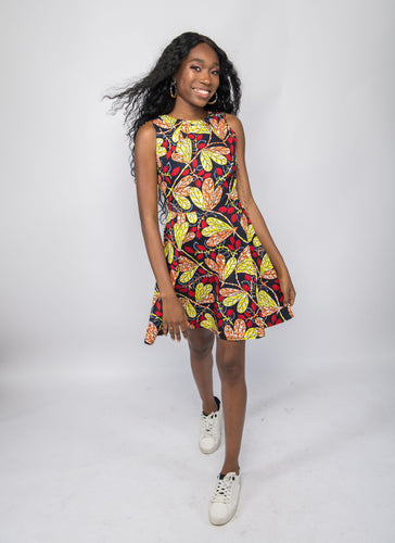 NIO STYLES │ Beautiful red leaf print flared print dress with splash of yellow. Round neck, Sleeveless design with side pockets and double gentle pleats.This is a gorgeous wear for an outing to the park or spice up with a pair of heels for work or an occasion, looking gracefully styled