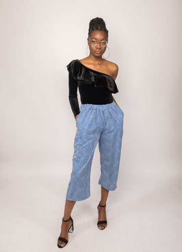 NIO STYLES │Striped blue and white viscose culotte with cropped length... wear this contemporary high rise pant with a white tank top and fine pair of sneakers for that cool summer look or pair with a jumper for a spring or fall look, looking graciously styled, uniquely you. Shop now..