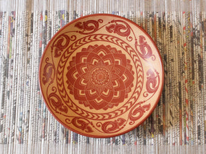 Terracotta pottery plate with hand-etched design Serendip