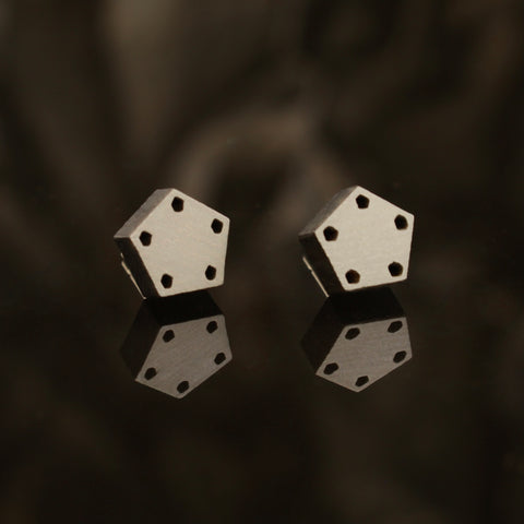 Small black pentagon wooden studs - handmade in Ireland by jewellery designer Rowena Sheen