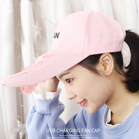 pink hat with fan on girl
