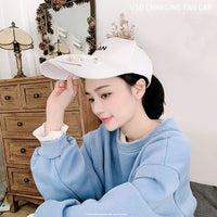 white hat with fan on a girl