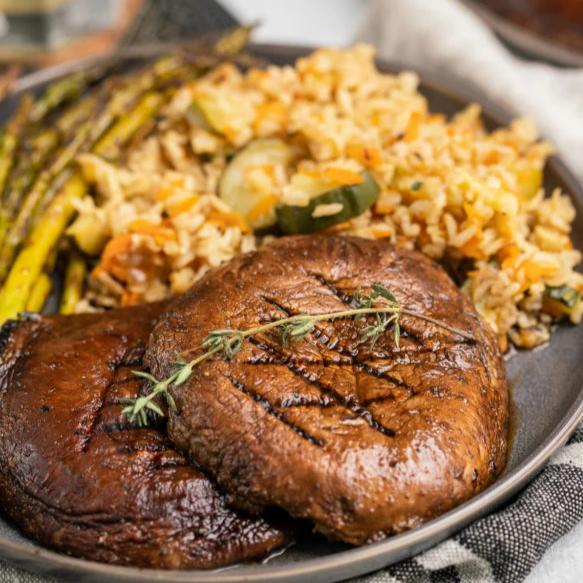 Grilled Portobello Steaks over Yellow Rice