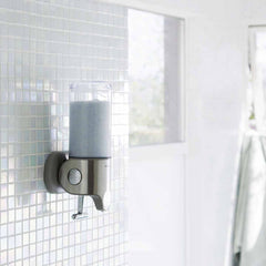 single wall mount pump - lifestyle in shower