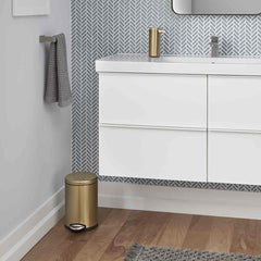 4.5L round pedal bin - brass finish - lifestyle in bathroom next to wall