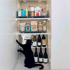 22.8cm pull-out cabinet organiser - lifestyle in cabinet with cat