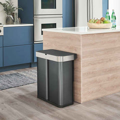58L dual compartment rectangular sensor bin with voice and motion control - black finish - lifestyle in kitchen next to island image